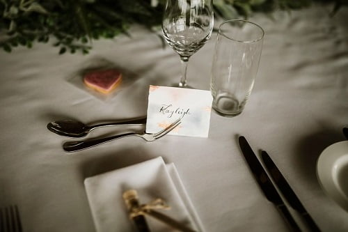 wedding reception table with a name card of a wedding guest